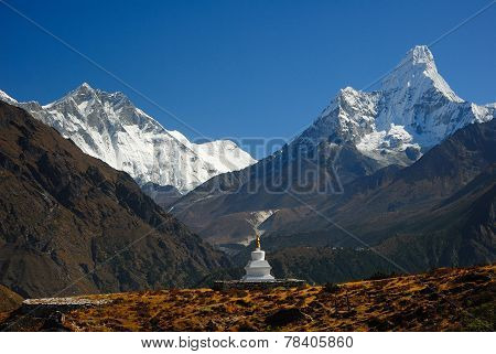 Buddhist Khumjung Stupa, Lhotse Peak And Ama Dablam Peak In Nepal