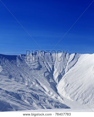 Off-piste Slope With Traces Of Avalanche In Sun Morning