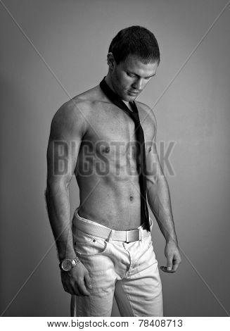 Attractive Muscular Man Posing With Tie. Black And White.
