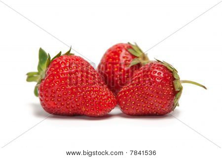 Three Fresh Strawberries Isolated On White Background