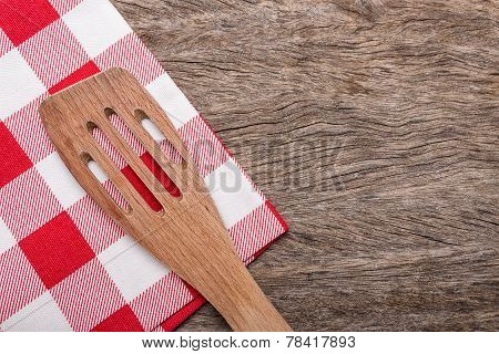 Wooden Spoon, Fork On Red Napkin For A Table. On Wooden Texture.