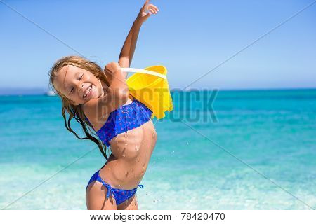 Adorable little girl have fun with beach toy at tropical beach