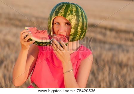woman model with water-melon on head