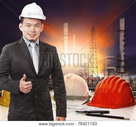 Young Petrochemical Engineer Standing In Front Of Working Tale Of Oil Refinery Industrial And Sign G