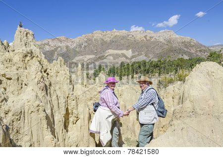 La Paz, Bolivia - Couple of senior tourists visiting Valle de la Luna (Moon Valley)