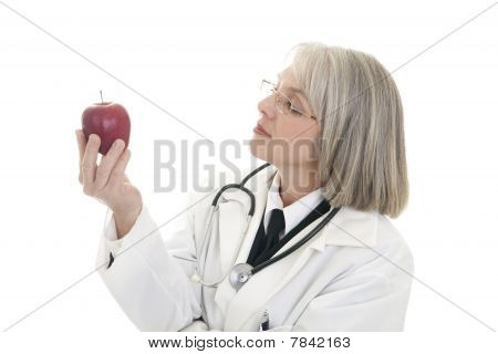 Mature Female Doctor Holding An Apple