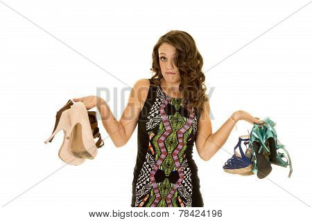 Woman Short Dress Hold Lots Of Shoes Unsure