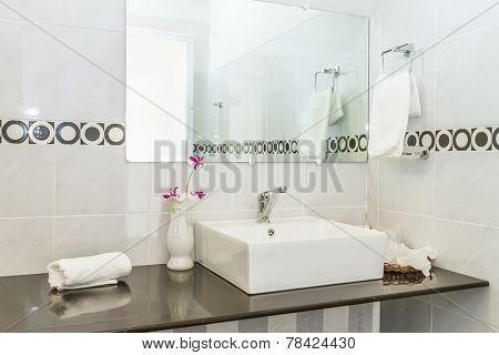 a tap in a white bathroom