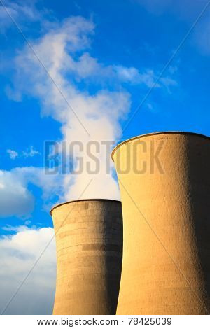 Two Cooling Tower In Geothermal Energy Power Station On Sunset.