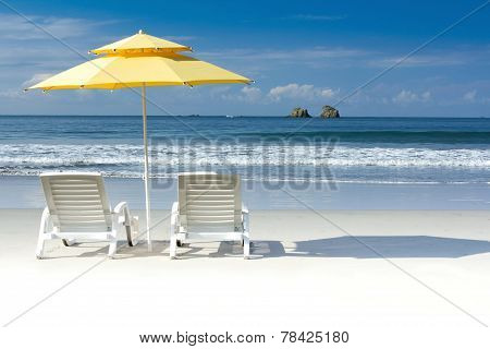 Yellow umbrella on tropical beach