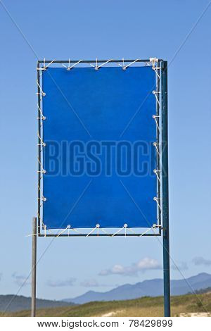 Blue beach sign for renting or selling beach products.