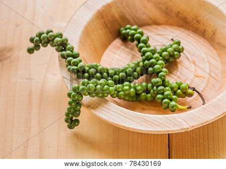 A fresh  green pepper bunch in an earthen bowl.