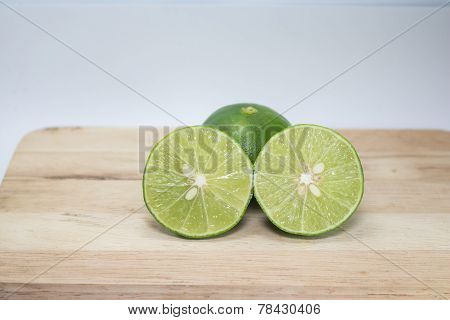 Green  lemon, cut in half