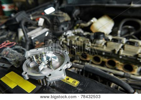 auto repair spare part turbine during automobile car maintenance at engine repair service station garage