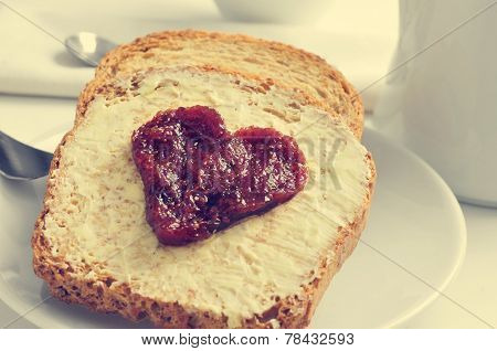 jam forming a heart on a toast, on a set table for breakfast
