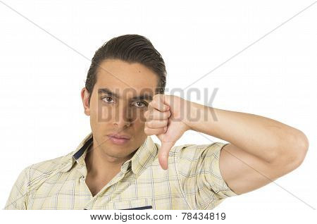 young handsome hispanic man posing with thumb down disappointed