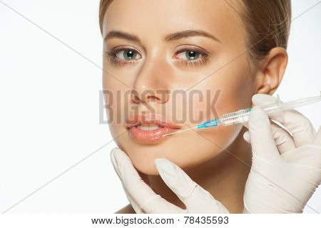 Cosmetic injection of botox to the pretty female lips. Healthcare and beauty concept