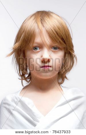 Boy With Blond Hair Looking - Isolated On Gray