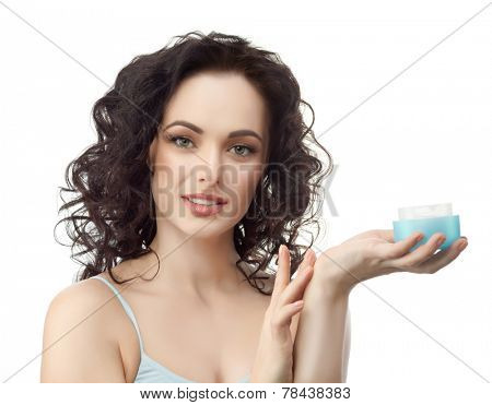 closeup portrait of attractive  caucasian woman brunette isolated on white studio shot lips  face hair head and shoulders looking at camera applying cream