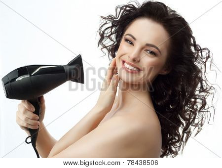 portrait of attractive  caucasian woman  with long brunette hair isolated on white studio shot making hairstyle with drier