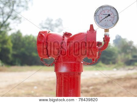 Red Metallic Fire Hydrant With Pressure Gauge Or Fire Department Connection On Street