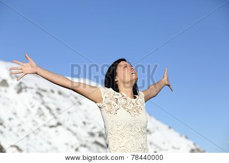 Happy Woman Breathing Deep Raising Arms In Winter