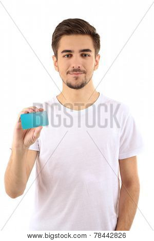 Handsome young man holds cutaway isolated on white