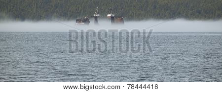 Landscape With Fog And Oil Platform. Vancouver. Canada