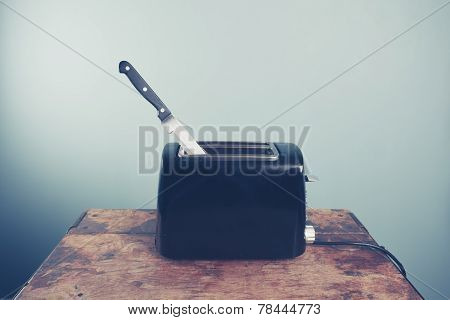 Toaster With Knife In It