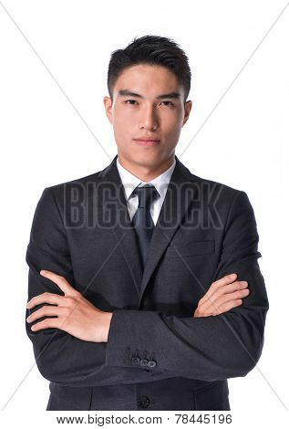 young businessman with crossed arms over white background