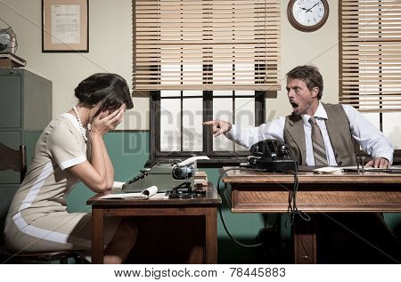 Boss Arguing With Young Secretary In The Office