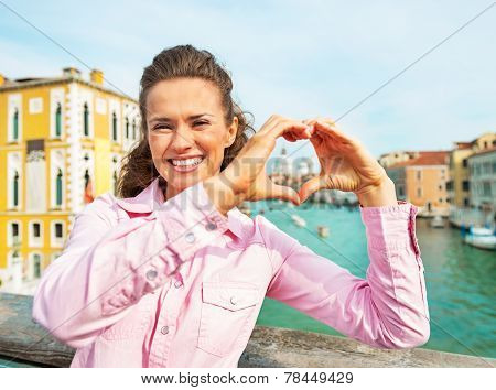 Happy Young Woman Showing Heart Shaped Hands Framing Santa Maria Della Salute Venice, Italy