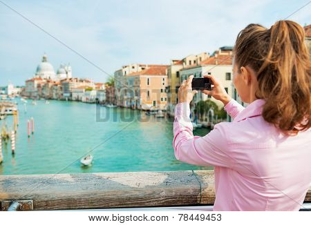 Young Woman Standing On Bridge With Grand Canal View In Venice,