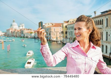 Happy Young Woman Standing On Bridge With Grand Canal View In Ve