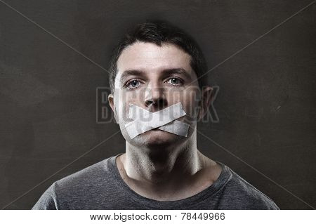 Attractive Young Man With Mouth Sealed On Duct Tape To Prevent Him From Speaking
