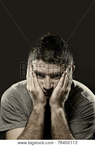Man Suffering Depression And Headache With Hands On Face In Stress