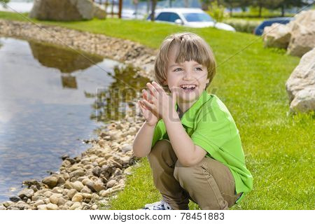 Kid Playing With Pebbles
