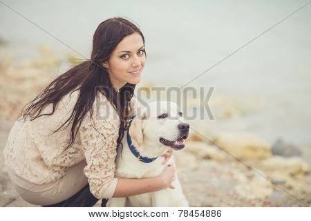 Girl with dog on the beach.