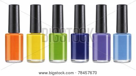 Group of bright nail polishes isolated