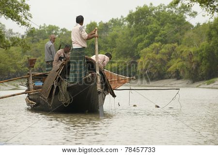 Men do fishing with otters, Mongla, Bangladesh.