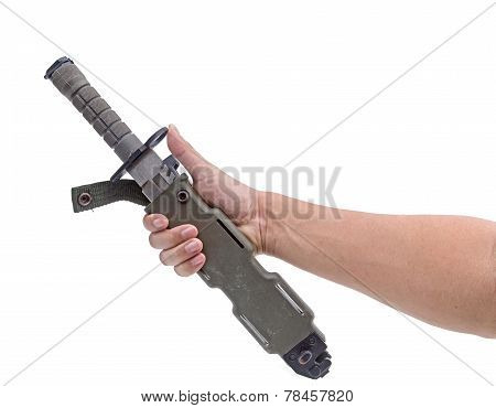 the hand holding Army green of modern  military knife isolated white