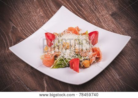 Cesar Salad With Salmon, Tomato, Croutons And Cheese