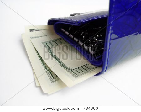 Blue wallet with one hundred dollar bill sticking out and isolat