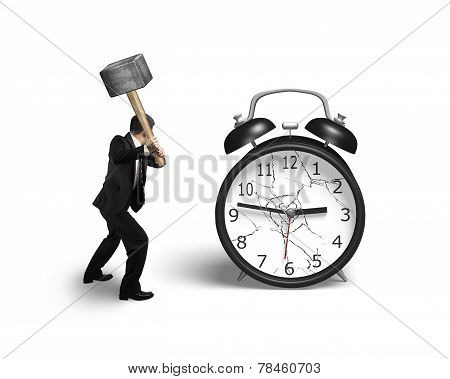 Businessman Hand Holding Sledgehammer Hitting Alarm Clock With Broken Glass