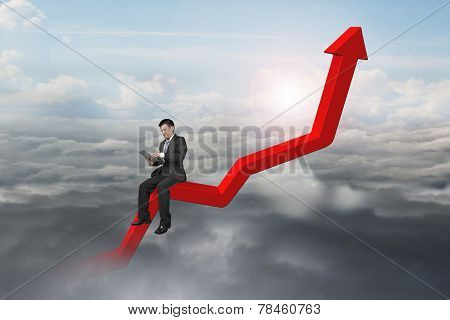 Businessman Using Tablet On Red Trend Chart With Daylight Cloudscape