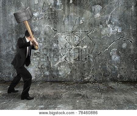 Businessman Using Sledgehammer Cracking Wall Broken On Concrete Floor