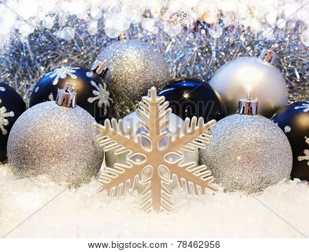 Christmas baubles nestled in snow