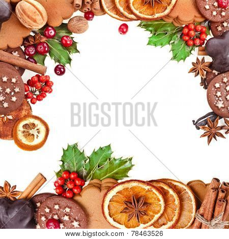 christmas card of cookies , berries , fruits , different xmas ingredients and spices on a white background
