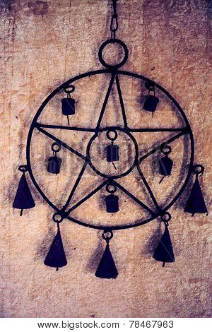 Pentagram with bells
