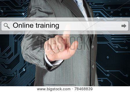 Businessman pushing virtual search bar with online training words